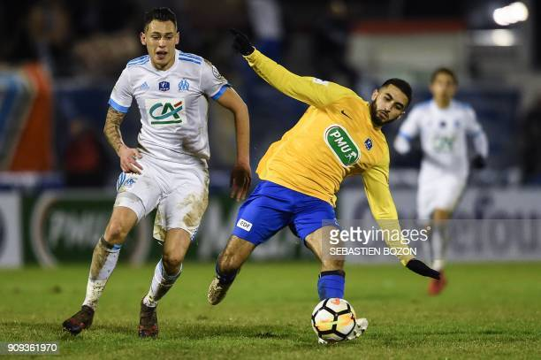 Epinal's French forward Mohamed Labhiri vies with Olympique de Marseille's Argentinian forward Lucas Ocampos during the French Cup round of 32...