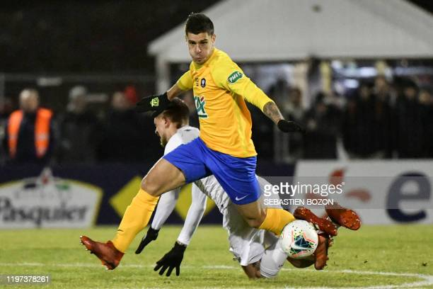 Epinal's French midfielder Jeremy Colin vies with Lille's Portugese midfielder Xeka during the French Cup roundof16 football match between Epinal and...