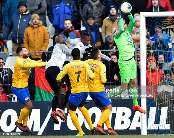 Epinal's goalkeeper Jerome Idir stops the ball during the French Cup football match between Epinal and SaintPierroise on January 18 at La Colombiere...
