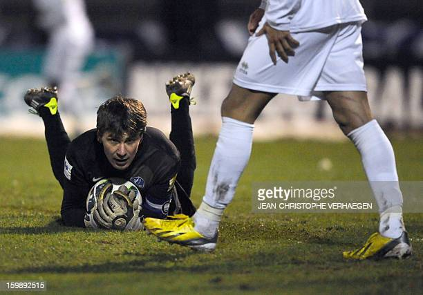 Epinal's goalkeeper Olivier Robin makes a save during the penalty shoot out of the French Cup football match between Epinal and Nantes at La...