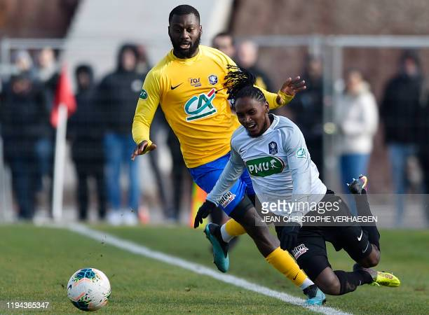 Epinal's midfielder Guy Tape vies with SaintPierroise's midfielder Ryan Ponti during the French Cup football match between Epinal and SaintPierroise...