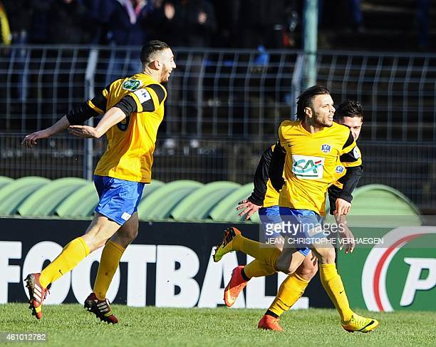 Epinal's players celebrate after scoring a goal during a French Cup round of 64 football match between Epinal and Metz on January 4 2015 at the...