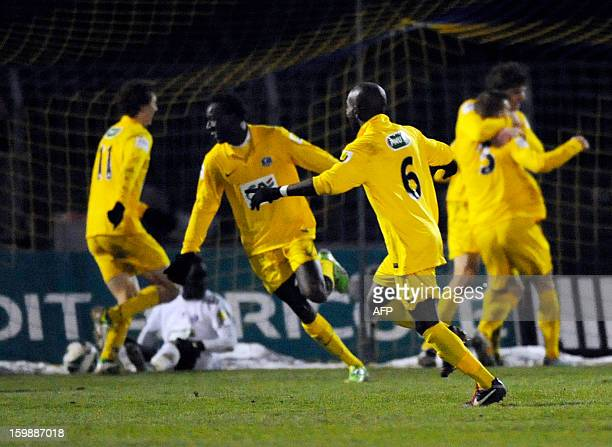 Epinal's players celebrate after scoring against Nantes during the French Cup football match Epinal vs Nantes at La Colombiere Stadium on January 22...