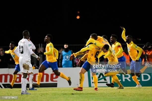 Epinal's players jubilates after scoring a goal during the French Cup roundof16 football match between Epinal and Lille at the stade de la Colombiere...