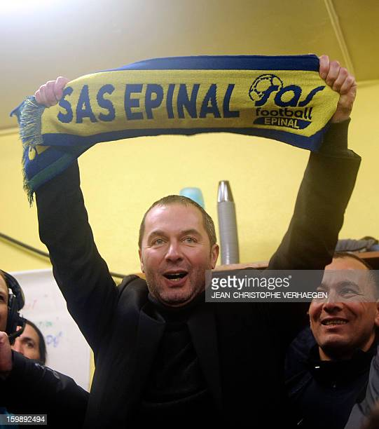 Epinal's president Stephane Viry celebrates at the end of the French Cup football match between Epinal and Nantes at La Colombiere stadium on January...