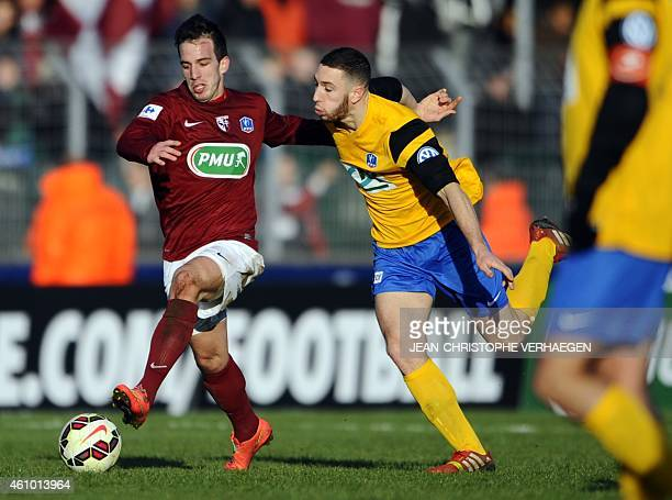 Epinal's Quentin Guyon vies with Metz' Argentine forward Federico Andrada during the French Cup round of 64 football match between Epinal and Metz on...