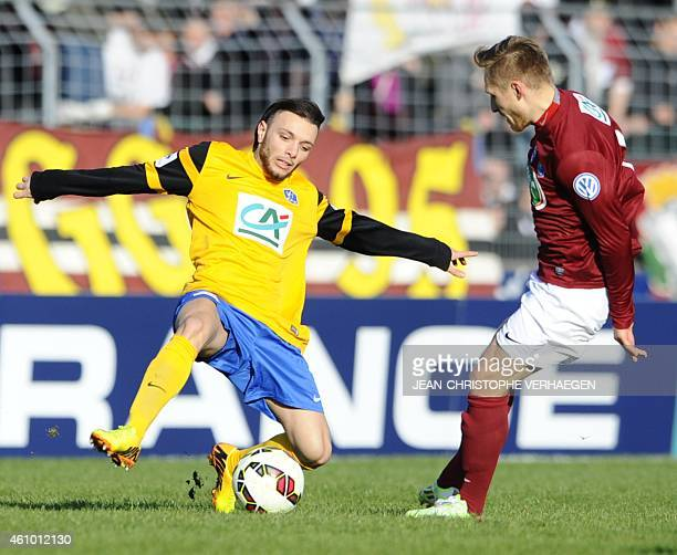 Epinal's Youcef Touati vies with Metz' midfielder Sergei Krivets during a French Cup round of 64 football match between Epinal and Metz on January 4...