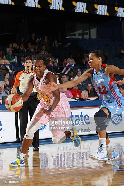 Epiphanny Prince of the Chicago Sky drives past Arminte Price of the Atlanta Dream on September 20 2012 at the Allstate Arena in Rosemont Illinois...