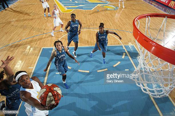 Epiphanny Prince of the Chicago Sky goes to the basket past Maya Moore Seimone Augustus Amber Harris and Rebekkah Brunson of the Minnesota Lynx...