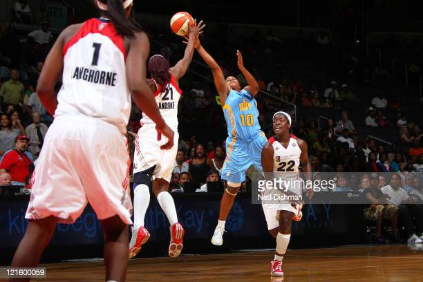 Epiphanny Prince of the Chicago Sky is fouled while shooting against Nicky Anosike of the Washington Mystics at the Verizon Center on August 20 2011...
