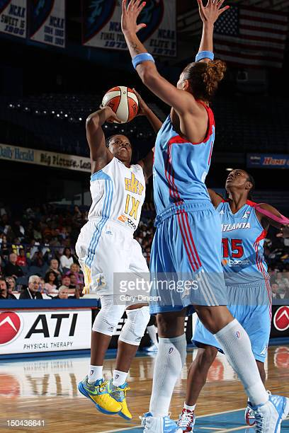 Epiphanny Prince of the Chicago Sky puts up a shot over Erika de Souza and Tiffany Hayes of the Atlanta Dream on August 17 2012 at the Allstate Arena...