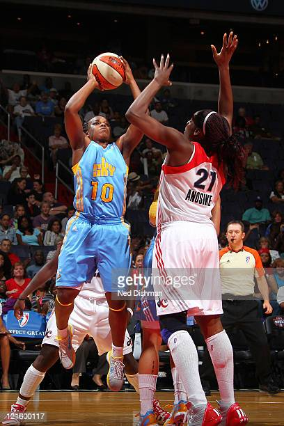 Epiphanny Prince of the Chicago Sky shoots against Nicky Anosike of the Washington Mystics at the Verizon Center on August 20 2011 in Washington DC...