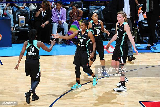 Epiphanny Prince of the New York Liberty shakes hands with her teammates in a WNBA game against the Atlanta Dream on July 12 2015 at Philips Arena in...