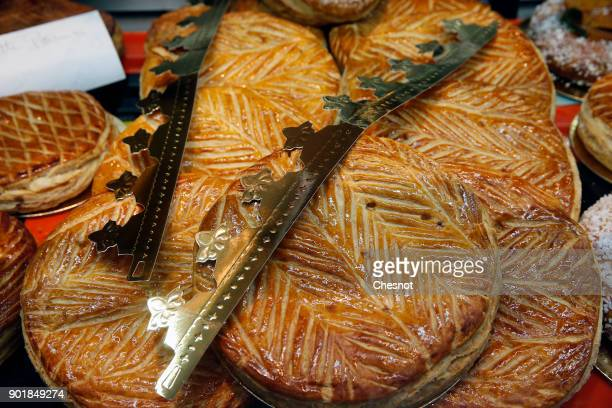 Epiphany cakes or Twelfth Night cake and Epiphany crowns are on display in the window of a pastry shop on January 06 2017 in Paris France The...