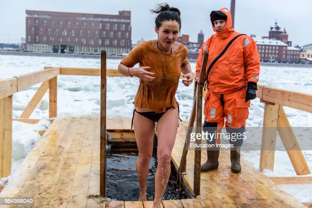 Epiphany ice hole diving in the Neva river in St Petersburg, Russia