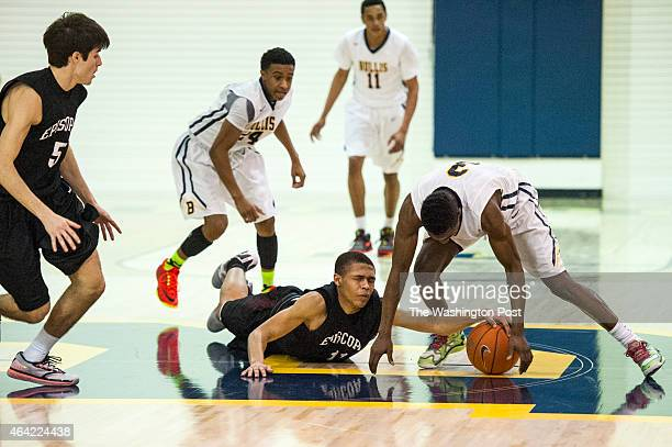 Episcopal Maroon and Black guard Nichlos Reed and Bullis Bulldogs guard Jamal Wright battle for possession in the first half at Bullis February 2015...
