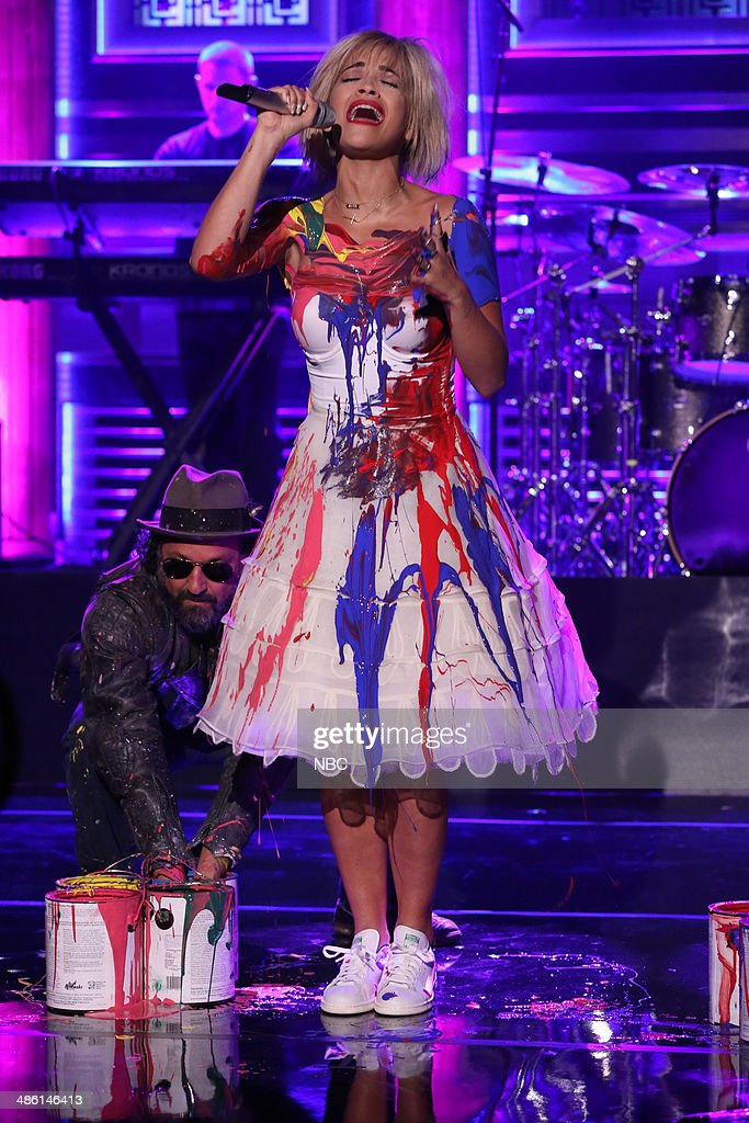 Musical guest Rita Ora performs with artist Thierry Guetta aka Mr. Brainwash on April 22, 2014 -- (Photo by: Nathaniel Chadwick/NBC/NBCU Photo Bank via Getty Images)..