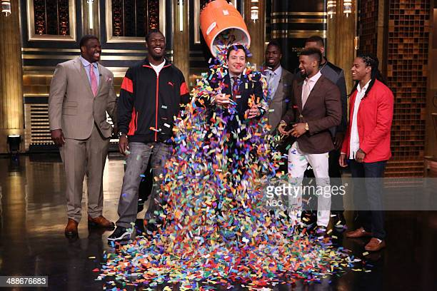 Football players and NFL draft prospects Greg Robinson Jadeveon Clowney CJ Mosley Odell Beckham Jr and Jason Verrett shower host Jimmy Fallon with...