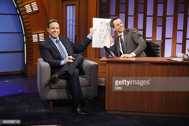Journalist Jake Tapper draws a caricature of host Seth Meyers during an interview on June 9 2014
