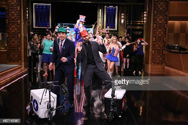 Host Jimmy Fallon races actor Hugh Jackman on coolerscooters on May 21 2014