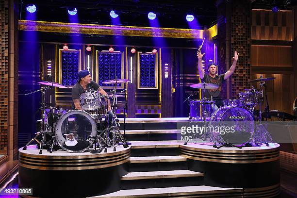 Episode 0064 -- Pictured: Drummer Chad Smith competes in a drum-off with actor Will Ferrell on May 22, 2014 --