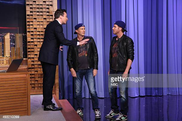 Host Jimmy Fallon greets drummer Chad Smith and actor Will Ferrell on May 22 2014