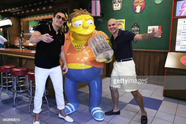 Host Jimmy Fallon and musical artist Pitbull play Giant Duff Beer Pong on June 19 2014