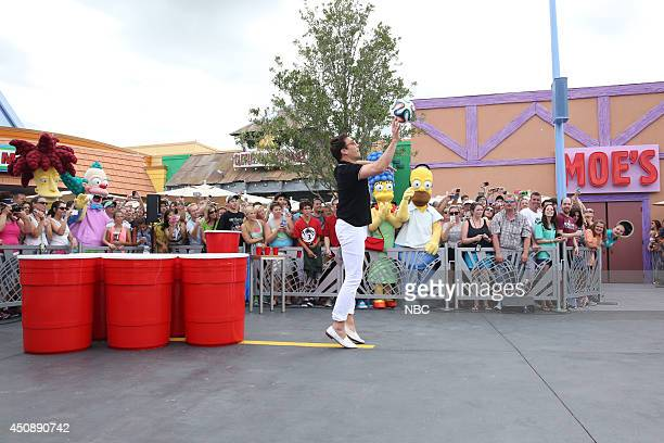 Host Jimmy Fallon plays 'Giant Duff Beer Pong' on June 19 2014