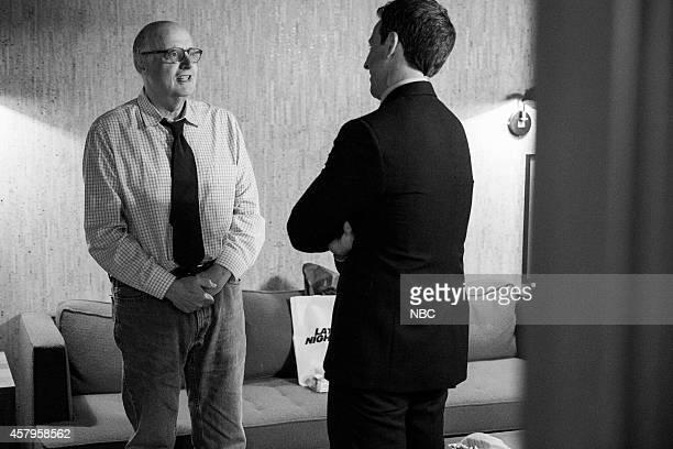 Actor Jeffrey Tambor talks with host Seth Meyers backstage on October 7 2014