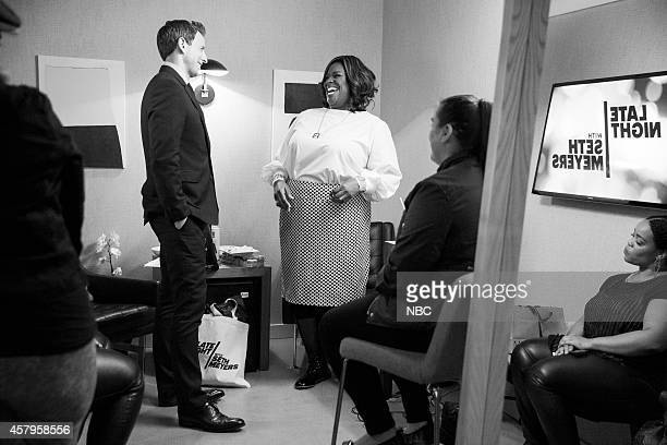 Episode 0109 -- Pictured: Host Seth Meyers talks with actress Retta backstage on October 7, 2014 --