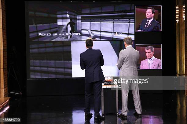Episode 0111 -- Pictured: Host Jimmy Fallon and actor Pierce Brosnan play Goldeneye on August 19, 2014 --