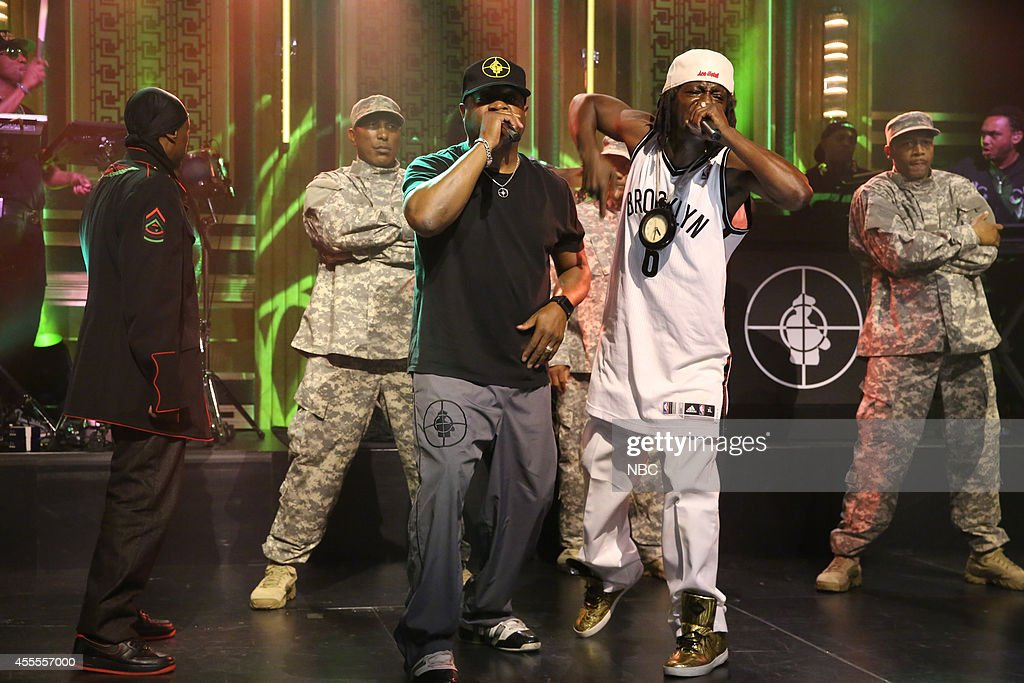 Professor Griff, Chuck D and Flavor Flav of musical guest Public Enemy perform with Tariq 'Black Thought' Trotter of The Roots on September 16, 2014 -- (Photo by: Douglas Gorenstein/NBC/NBCU Photo Bank via Getty Images).