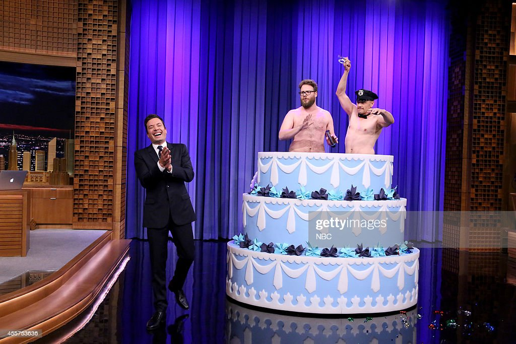 Host Jimmy Fallon is surprised by actor Seth Rogen and actor James Franco on September 19, 2014 --