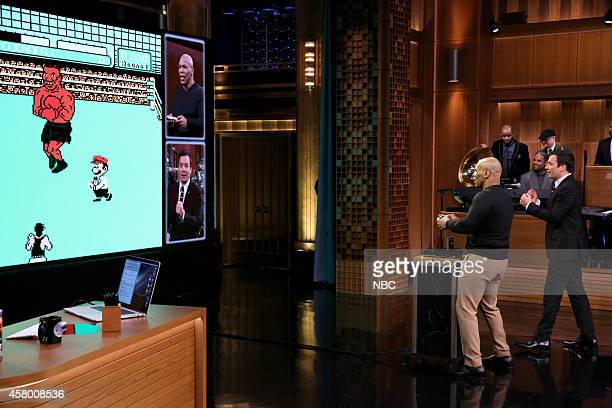"""Episode 0150 -- Pictured: Professional Boxer Mike Tyson plays the """"Punch Out"""" video game as host Jimmy Fallon watches on October 28, 2014 --"""