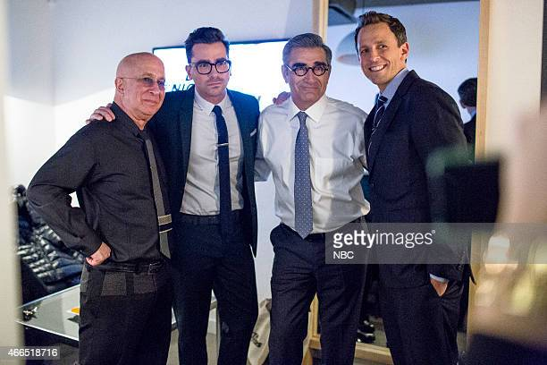 CBS Orchestra band leader Paul Shaffer actors Daniel Levy Eugene Levy and host Seth Meyers pose for a photo backstage on February 9 2015