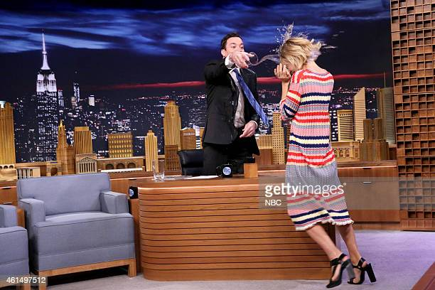 Episode 0193 -- Pictured: Host Jimmy Fallon and actress Sienna Miller throw water on each other on January 13, 2015 --