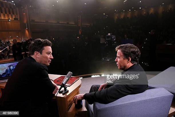 Host Jimmy Fallon and sportscaster Bob Costas talk during a commercial break on January 22 2015