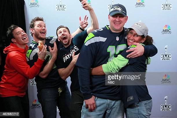 Host Jimmy Fallon actor Christ Pratt and actor Chris Evans pose with a couple during the Photobomb skit on February 2 2015