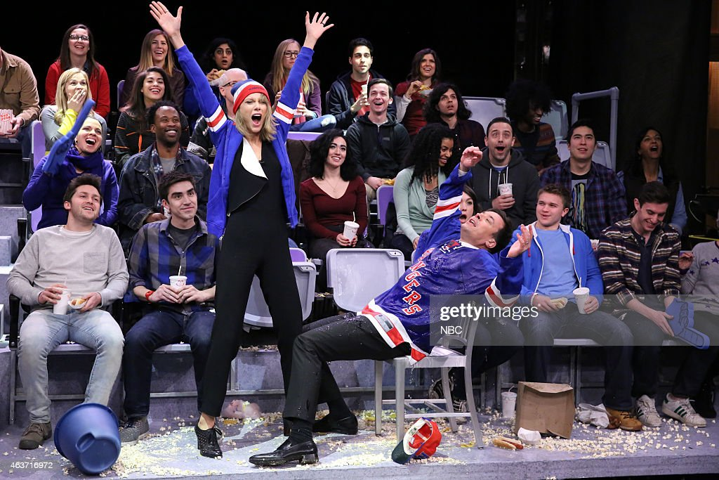 Musician Taylor Swift and host Jimmy Fallon during the 'Jumbotron Dancers' skit on February 17, 2015 --