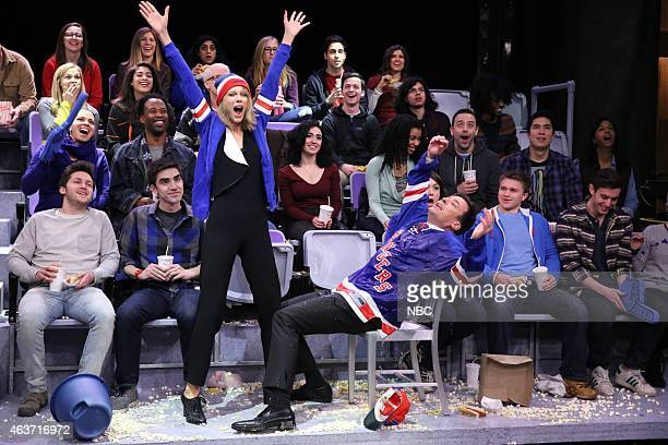 Musician Taylor Swift and host Jimmy Fallon during the Jumbotron Dancers skit on February 17 2015