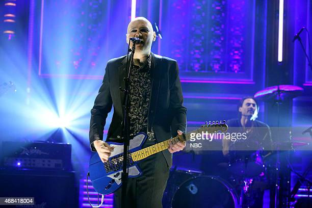 Billy Corgan and Brad Wilk of musical guest The Smashing Pumpkins perform on April 2 2015