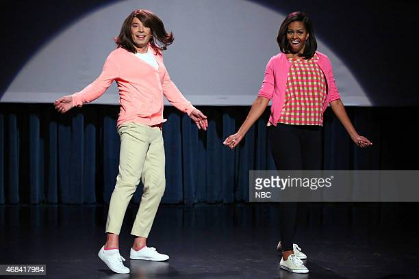 Host Jimmy Fallon and First Lady Michelle Obama during the 'Evolution of Mom Dancing Part 2' skit on April 2 2015