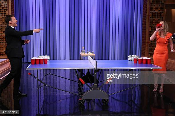 Host Jimmy Fallon plays beer pong with Actress Helen Hunt on May 1 2015