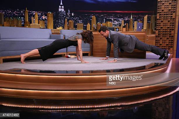 Episode 0266 -- Pictured: Actress Carla Gugino does pushups with host Jimmy Fallon on May 19, 2015 --