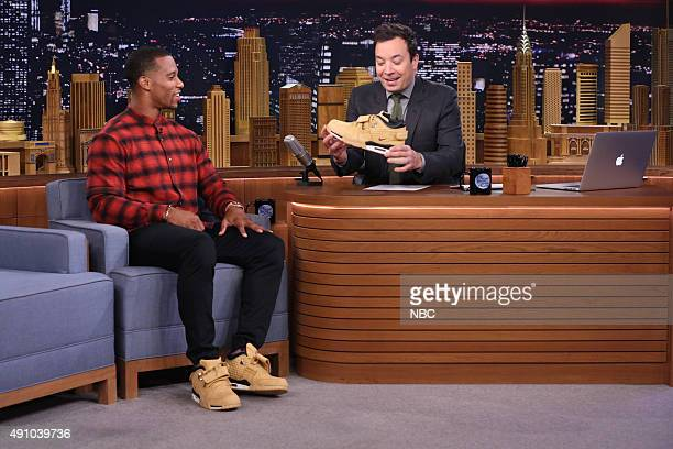 Episode 0342 -- Pictured: Professional football player Victor Cruz during an interview with host Jimmy Fallon on October 2, 2015 --