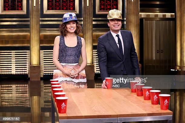 Actress Daisy Ridley and host Jimmy Fallon play Flip Cup on December 3 2015