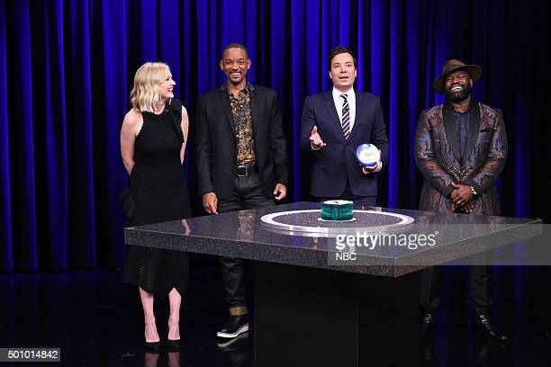Actress Kirsten Dunst Actor Will Smith host Jimmy Fallon and Tariq Black Thought Trotter play Catchphrase on December 11 2015
