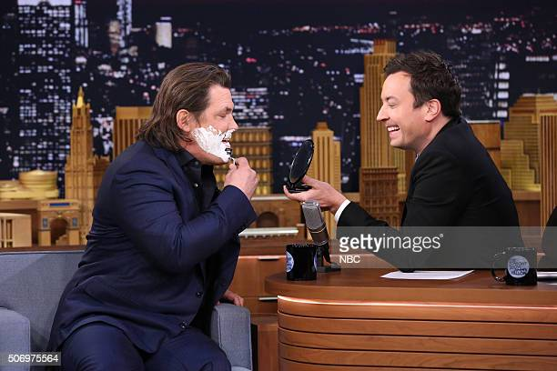 Actor Josh Brolin shaves during an interview with host Jimmy Fallon on January 26 2016