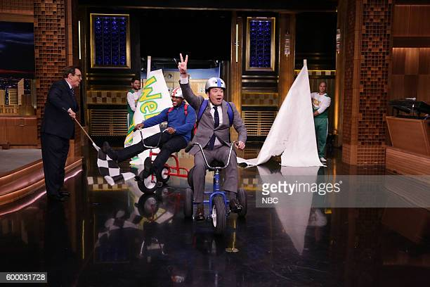 Football player Michael Strahan and host Jimmy Fallon during the Giant Tricycle Race on September 7 2016