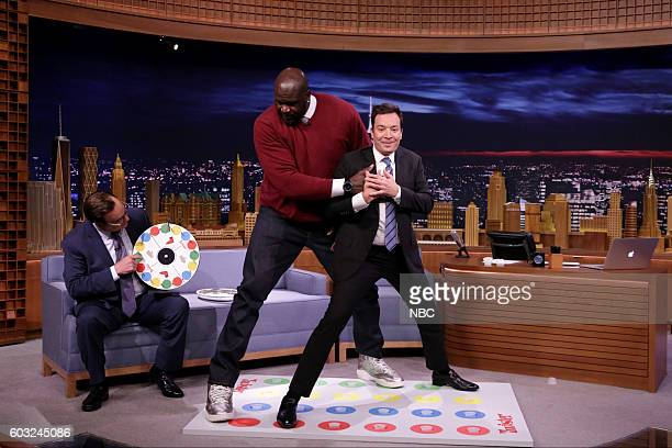 Announcer Steve Higgins basketball player Shaquille O'Neal and host Jimmy Fallon play 'Jello Shot Twister' on September 12 2016
